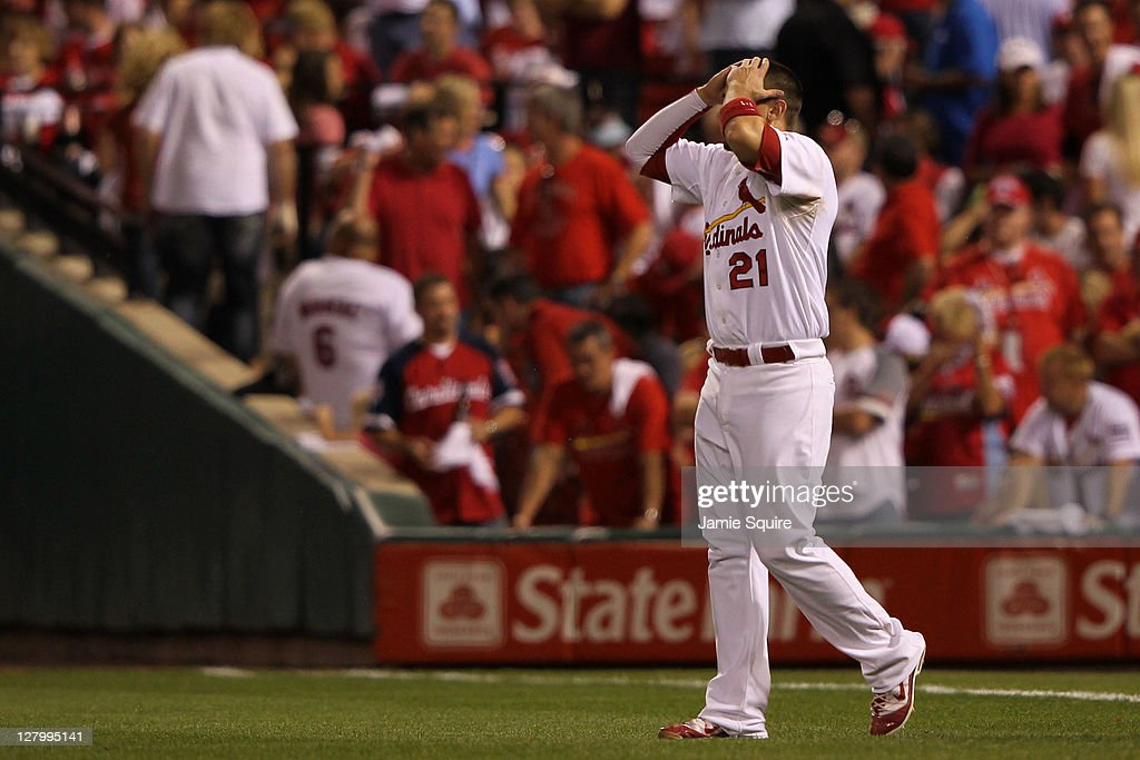 Allen Craig #21 of the St. Louis Cardinals reacts after hitting in to a double play to end the eighth inning of Game Three of the National League Division Series against the Philadelphia Phillies at Busch Stadium on October 4, 2011 in St Louis, Missouri.