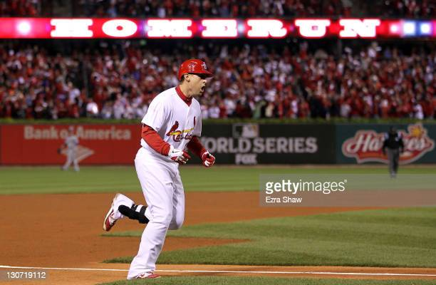 Allen Craig of the St Louis Cardinals rounds the bases after hitting a solo home run in the third inning during Game Seven of the MLB World Series...