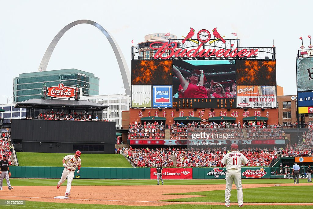 Allen Craig #21 of the St. Louis Cardinals rounds third base after hitting a two-run home run in the fourth inning against the Miami Marlins at Busch Stadium on July 5, 2014 in St. Louis, Missouri.