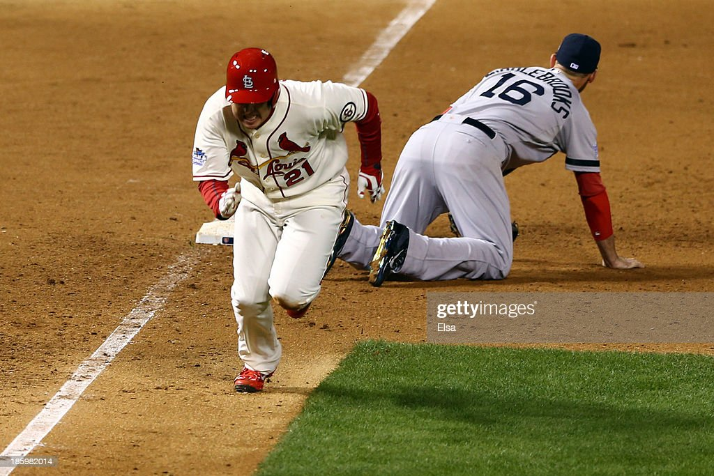 <a gi-track='captionPersonalityLinkClicked' href=/galleries/search?phrase=Allen+Craig&family=editorial&specificpeople=4405049 ng-click='$event.stopPropagation()'>Allen Craig</a> #21 of the St. Louis Cardinals runs after being tripped up by <a gi-track='captionPersonalityLinkClicked' href=/galleries/search?phrase=Will+Middlebrooks&family=editorial&specificpeople=7934204 ng-click='$event.stopPropagation()'>Will Middlebrooks</a> #16 of the Boston Red Sox during the ninth inning of Game Three of the 2013 World Series at Busch Stadium on October 26, 2013 in St Louis, Missouri.