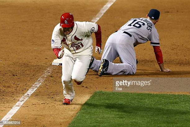Allen Craig of the St Louis Cardinals runs after being tripped up by Will Middlebrooks of the Boston Red Sox during the ninth inning of Game Three of...