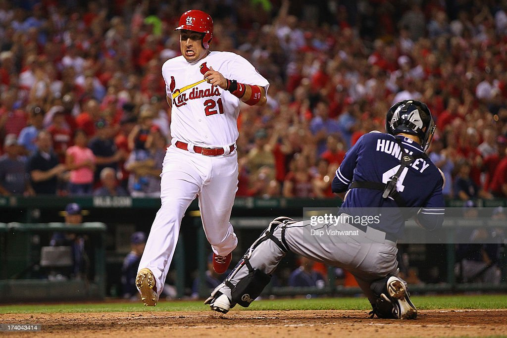<a gi-track='captionPersonalityLinkClicked' href=/galleries/search?phrase=Allen+Craig&family=editorial&specificpeople=4405049 ng-click='$event.stopPropagation()'>Allen Craig</a> #21 of the St. Louis Cardinals scores a run against the San Diego Padres in the seventh inning at Busch Stadium on July 19, 2013 in St. Louis, Missouri. The Cardinals beat the Padres 9-6.