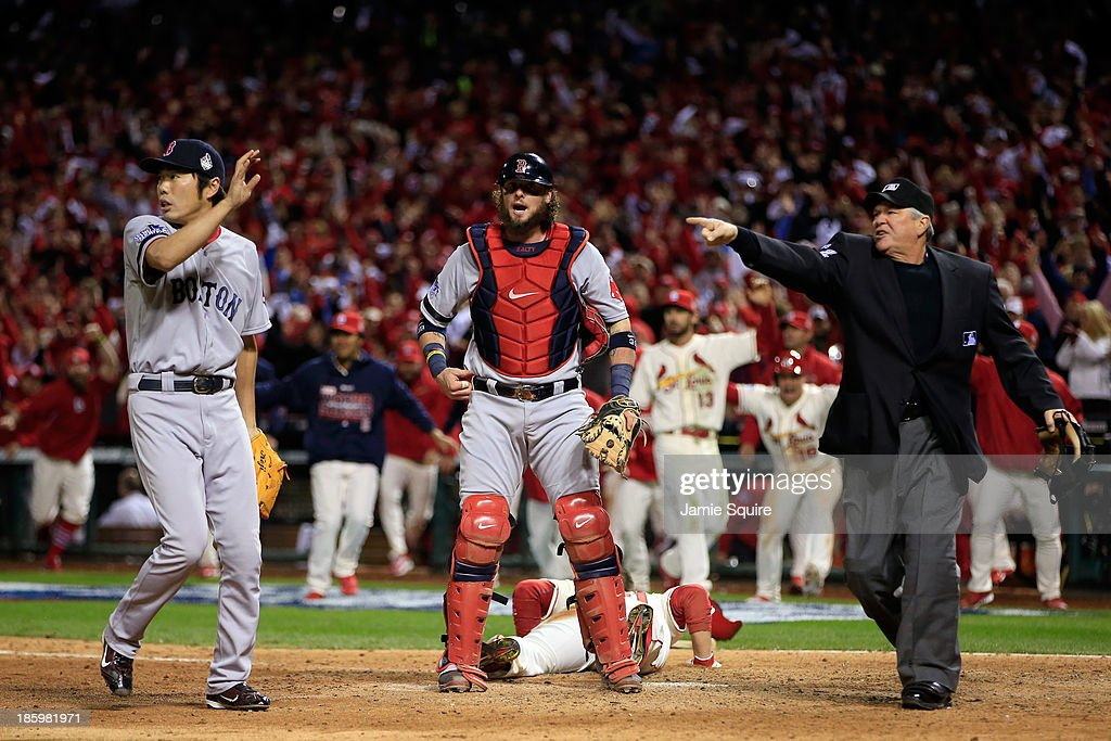 <a gi-track='captionPersonalityLinkClicked' href=/galleries/search?phrase=Allen+Craig&family=editorial&specificpeople=4405049 ng-click='$event.stopPropagation()'>Allen Craig</a> #21 of the St. Louis Cardinals scores on a feilder's choice by Jon Jay #19 in the ninth inning as <a gi-track='captionPersonalityLinkClicked' href=/galleries/search?phrase=Jarrod+Saltalamacchia&family=editorial&specificpeople=836404 ng-click='$event.stopPropagation()'>Jarrod Saltalamacchia</a> #39 and <a gi-track='captionPersonalityLinkClicked' href=/galleries/search?phrase=Koji+Uehara&family=editorial&specificpeople=801278 ng-click='$event.stopPropagation()'>Koji Uehara</a> #19 of the Boston Red Sox react during Game Three of the 2013 World Series at Busch Stadium on October 26, 2013 in St Louis, Missouri.