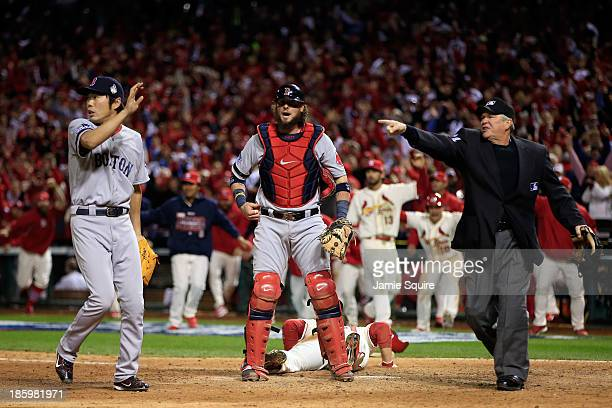 Allen Craig of the St Louis Cardinals scores on a feilder's choice by Jon Jay in the ninth inning as Jarrod Saltalamacchia and Koji Uehara of the...