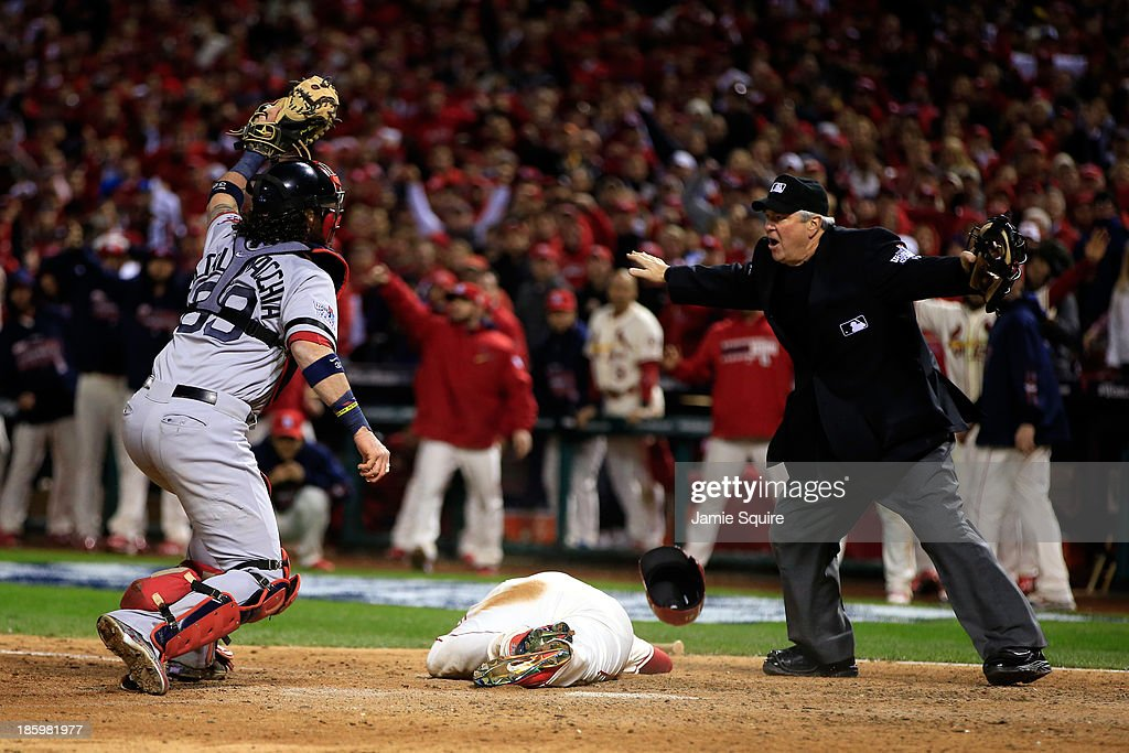 <a gi-track='captionPersonalityLinkClicked' href=/galleries/search?phrase=Allen+Craig&family=editorial&specificpeople=4405049 ng-click='$event.stopPropagation()'>Allen Craig</a> #21 of the St. Louis Cardinals scores on a feilder's choice by Jon Jay #19 in the ninth inning as <a gi-track='captionPersonalityLinkClicked' href=/galleries/search?phrase=Jarrod+Saltalamacchia&family=editorial&specificpeople=836404 ng-click='$event.stopPropagation()'>Jarrod Saltalamacchia</a> #39 of the Boston Red Sox reacts during Game Three of the 2013 World Series at Busch Stadium on October 26, 2013 in St Louis, Missouri.