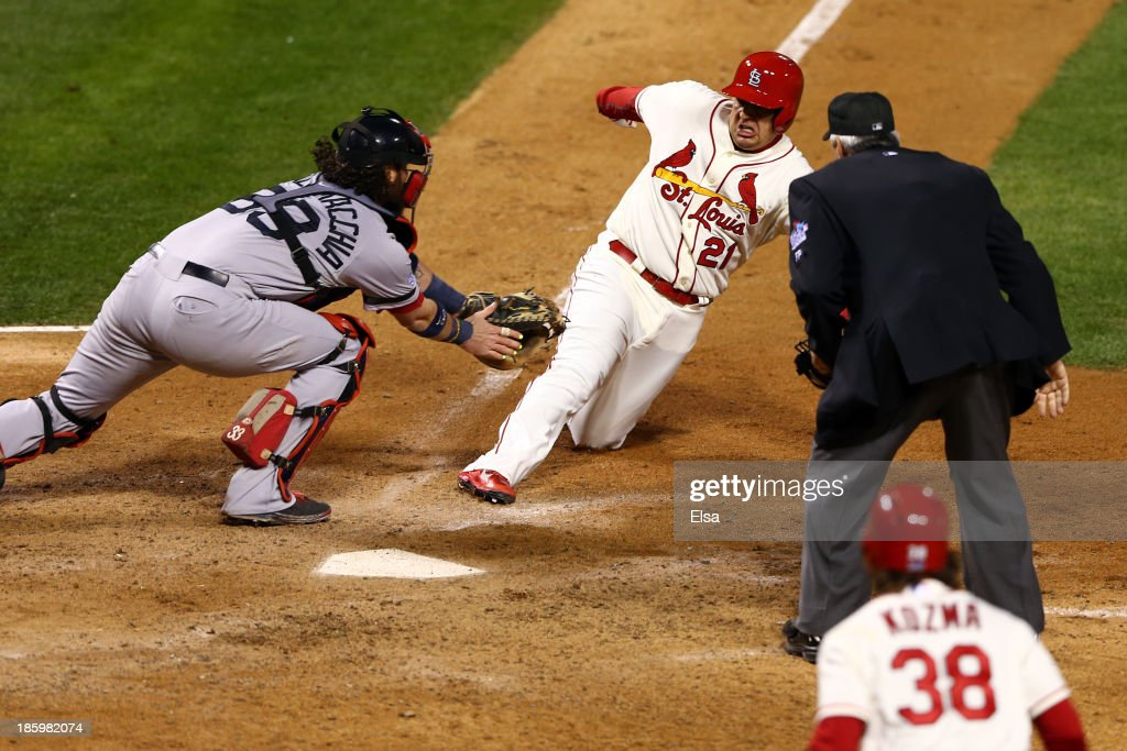 Allen Craig of the St Louis Cardinals scores on a feilder's choice by Jon Jay in the ninth inning as Jarrod Saltalamacchia of the Boston Red Sox...