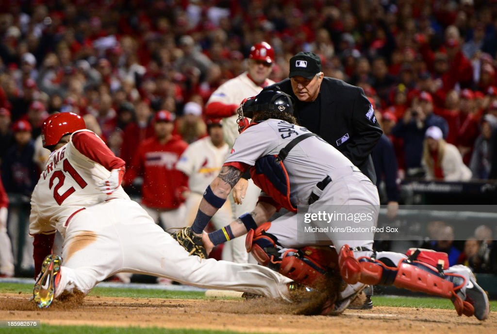 <a gi-track='captionPersonalityLinkClicked' href=/galleries/search?phrase=Allen+Craig&family=editorial&specificpeople=4405049 ng-click='$event.stopPropagation()'>Allen Craig</a> #21 of the St. Louis Cardinals slides into home with the winning run despite a tag by <a gi-track='captionPersonalityLinkClicked' href=/galleries/search?phrase=Jarrod+Saltalamacchia&family=editorial&specificpeople=836404 ng-click='$event.stopPropagation()'>Jarrod Saltalamacchia</a> #39 of the Boston Red Sox in the ninth inning of Game Three of the 2013 World Series on October 26, 2013 at Busch Stadium in St. Louis, Missouri. Third baseman Will Middlebrooks #16 was called for obstruction on the play which led to the run.