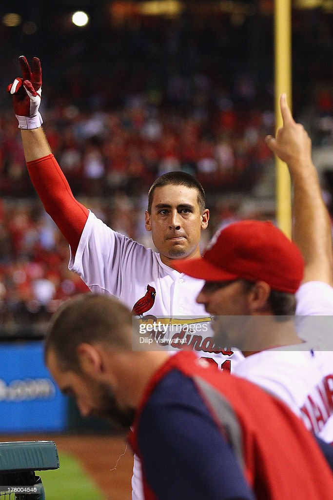 Allen Craig #21 of the St. Louis Cardinals takes a curtain call after hitting a grand slam against reliever J.J. Hoover #60 of the Cincinnati Reds in the seventh inning at Busch Stadium on August 26, 2013 in St. Louis, Missouri.