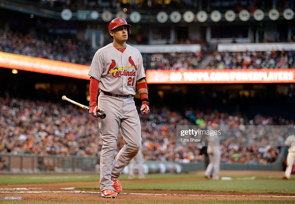 Allen Craig #21 of the St. Louis Cardinals walks back to the dugout after striking out with the bases loaded in the fourth inning against the San Francisco Giants at AT&T Park on July 1, 2014 in San Francisco, California.