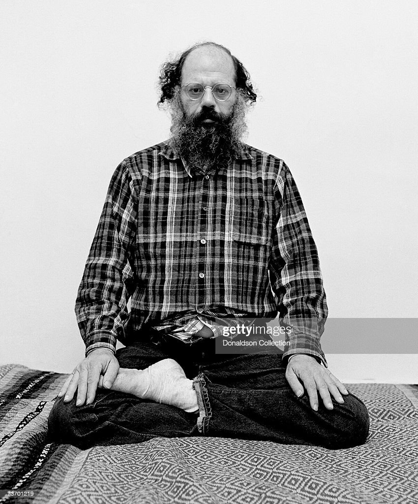 Allen Ginsberg poses at his residence during a photoshoot held in 1974 in New York City.