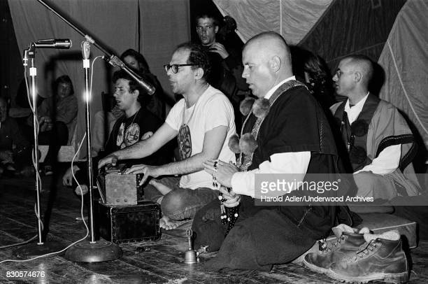 Allen Ginsberg with members of the Cockettes and the Magic Theater at the Julian Theater at a benefit for The Living Theater's defense fund San...