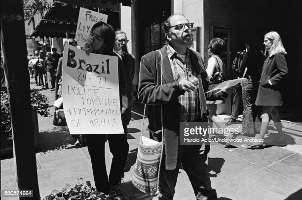 Allen Ginsberg with members of the Julian Theater around Union Square San Francisco California 1971 They were demonstrating against the arrests of...