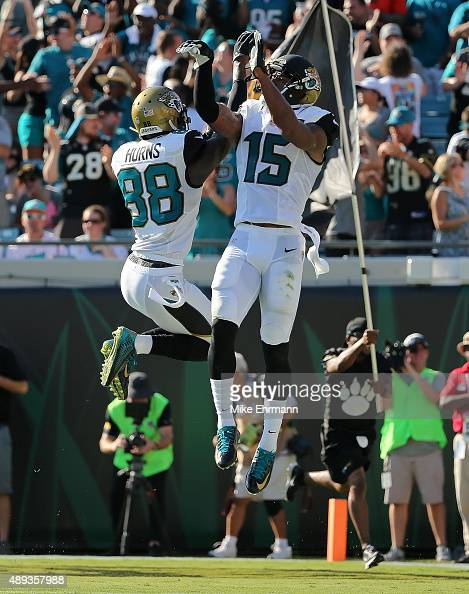 Allen Hurns and Allen Robinson of the Jacksonville Jaguars celebrate a touchdown during a game against the Miami Dolphins at EverBank Field on...