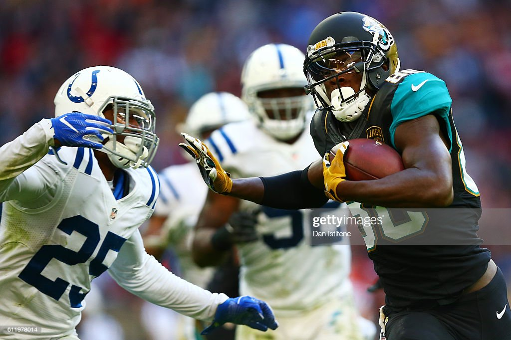 Allen Hurns #88 of the Jacksonville Jaguars hands off Patrick Robinson #25 of the Indianapolis Colts to score a touchdown during the NFL game between Indianapolis Colts and Jacksonville Jaguars at Wembley Stadium on October 2, 2016 in London, England.