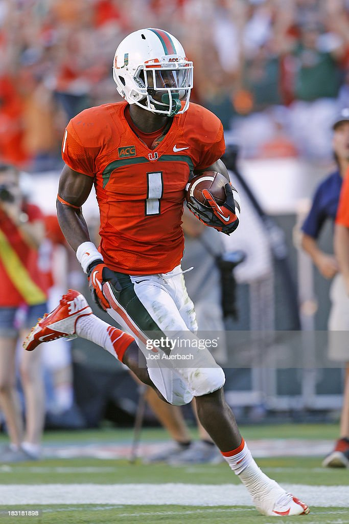 <a gi-track='captionPersonalityLinkClicked' href=/galleries/search?phrase=Allen+Hurns&family=editorial&specificpeople=7363092 ng-click='$event.stopPropagation()'>Allen Hurns</a> #1 of the Miami Hurricanes runs 69 yards for a touchdown against the Georgia Tech Yellow Jackets in the third quarter on October 5, 2013 at Sun Life Stadium in Miami Gardens, Florida. The Hurricanes defeated the Yellow Jackets 45-30.