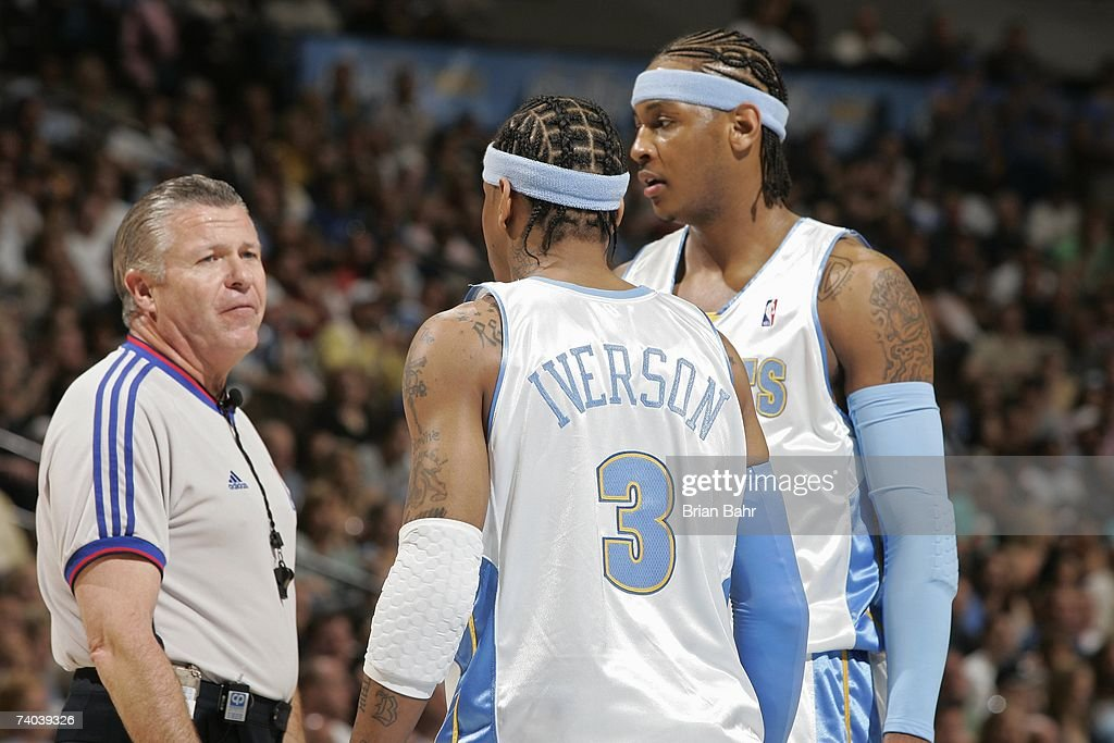 Allen Iverson #3 and <a gi-track='captionPersonalityLinkClicked' href=/galleries/search?phrase=Carmelo+Anthony&family=editorial&specificpeople=201494 ng-click='$event.stopPropagation()'>Carmelo Anthony</a> #15 of the Denver Nuggets talk to referee Bob Delaney during the game against the San Antonio Spurs in Game Three of the Western Conference Quarterfinals during the 2007 NBA Playoffs at the Pepsi Center on April 28, 2007 in Denver, Colorado. The Spurs won 96-91.