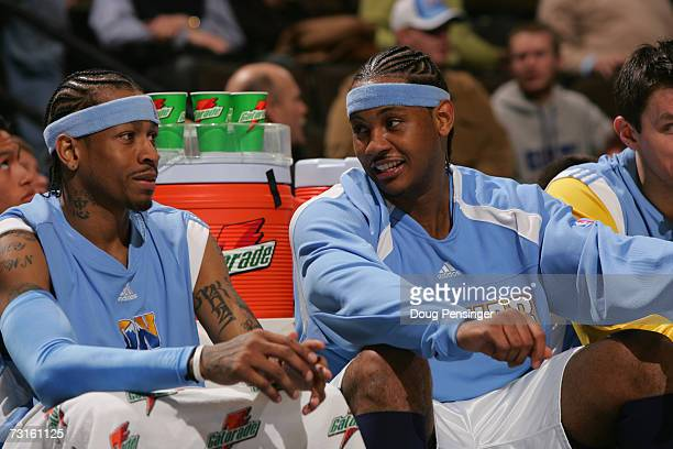Allen Iverson and Carmelo Anthony of the Denver Nuggets talk while sitting on the bench during the NBA game against the Memphis Grizzlies at the...