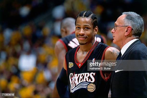 Allen Iverson and head coach Larry Brown of the Philadelphia 76ers have a conversation against the Los Angeles Lakers during game two of the 2001 NBA...
