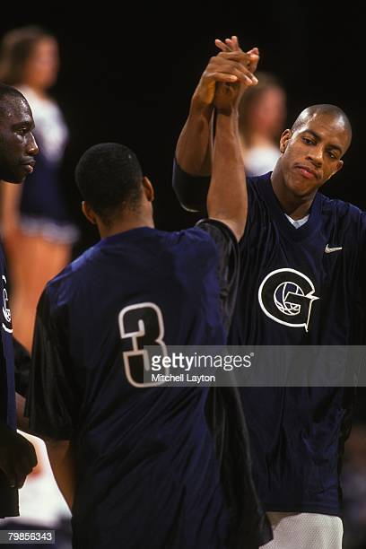 Allen Iverson and Jerome Williams of the Georgetown Hoyas during introductions of a basketball game at USAIr Arena on December 1 1995 in Landover...