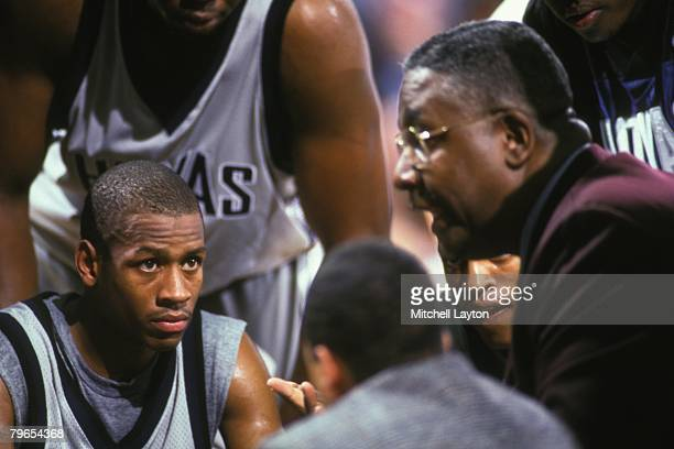 Allen Iverson and John Thompson head coach of Georgetown Hoyas during a time out of a basketball game at Capital Centre on December 1 1994 in...