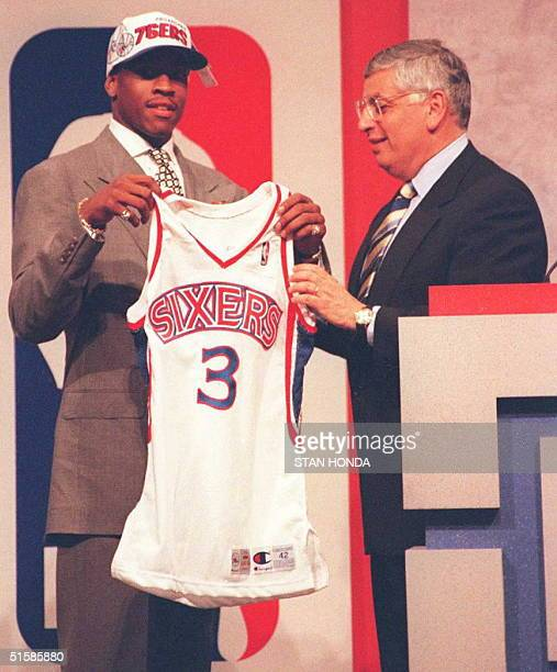 Allen Iverson holds Philadelphia 76ers' jersey with NBA commissioner David Stern after being the first pick in the NBA draft 26 June at the...