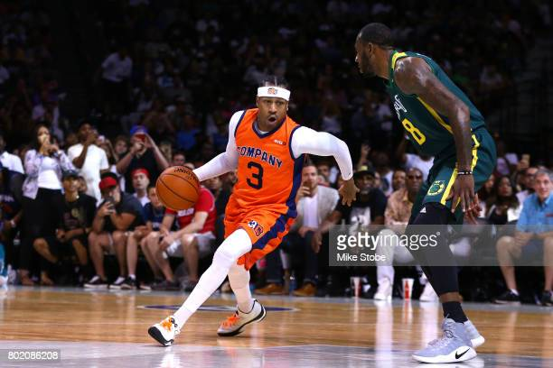 Allen Iverson of 3's Company handles the ball against Dominic McGuire of the Ball Hogs during week one of the BIG3 three on three basketball league...