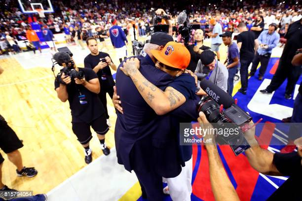 Allen Iverson of 3's Company hugs coach Julius 'Dr J' Erving of TriState during week four of the BIG3 three on three basketball league at Wells Fargo...