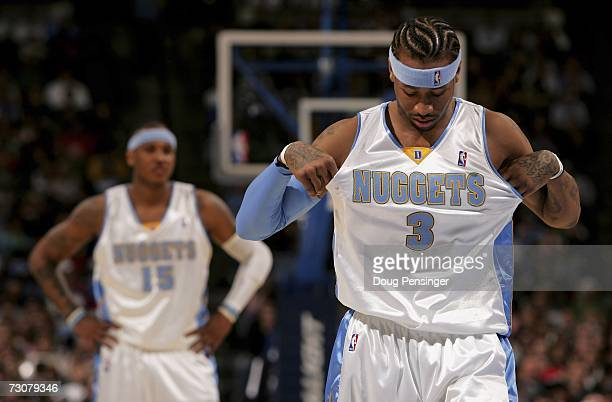 Allen Iverson of the Denver Nuggets adjusts his jersey as Carmelo Anthony awaits a freethrow as the Nuggets defeated the Memphis Grizzlies 11598 at...
