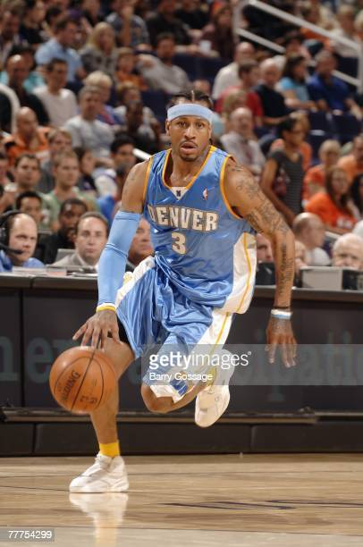 Allen Iverson of the Denver Nuggets drive to the basket during a preseason game against the Phoenix Suns at US Airways Center on October 25 2007 in...