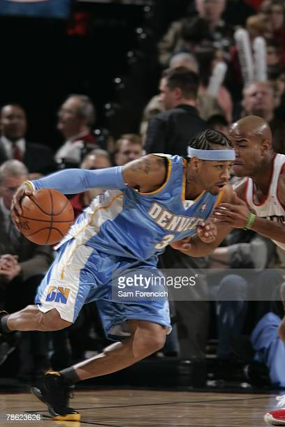 Allen Iverson of the Denver Nuggets drives around Jarrett Jack of the Portland Trail Blazers during a game on December 21 2007 at the Rose Garden...