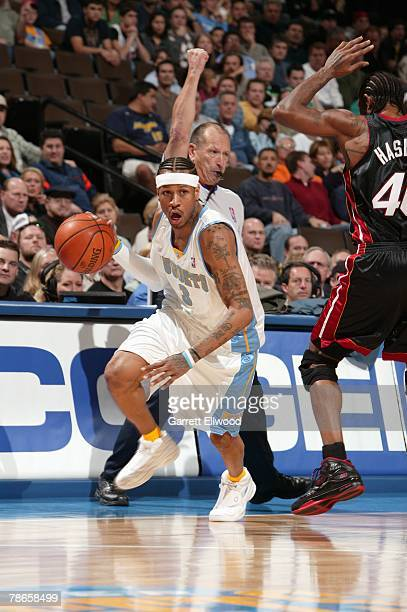 Allen Iverson of the Denver Nuggets drives to the basket against Udonis Haslem of the Miami Heat during the game at Pepsi Center on December 2 2005...