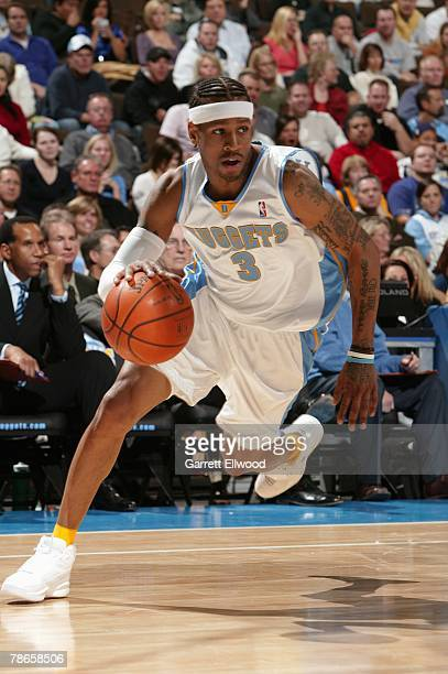 Allen Iverson of the Denver Nuggets drives to the basket during the game against the Miami Heat at Pepsi Center on December 2 2005 in Denver Colorado...