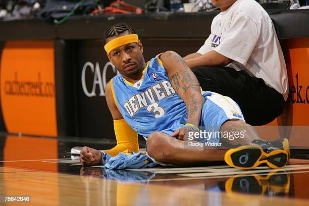Allen Iverson of the Denver Nuggets gets ready to enter the game against the Sacramento Kings at ARCO Arena December 23 2007 in Sacramento California...