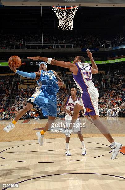 Allen Iverson of the Denver Nuggets goes up for a shot up against Shawn Marion of the Phoenix Suns in NBA preseason action at US Airways Center...