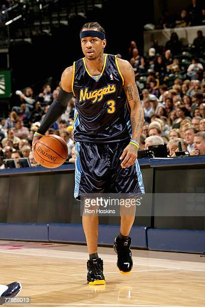 Allen Iverson of the Denver Nuggets handles the ball during the game against the Indiana Pacers on November 10 2007 at Conseco Fieldhouse in...