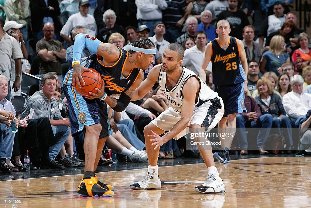 Allen Iverson #31 of the Denver Nuggets holds the ball against Tony Parker #9 of the San Antonio Spurs in Game One of the Western Conference Quarterfinals during the 2007 NBA Playoffs at AT&T Center on April 22, 2007 in San Antonio, Texas. The Nuggets won 95-89.