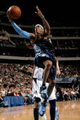 Allen Iverson of the Denver Nuggets lays the ball up during the game against the Dallas Mavericks on January 27 2008 at American Airlines Center in...