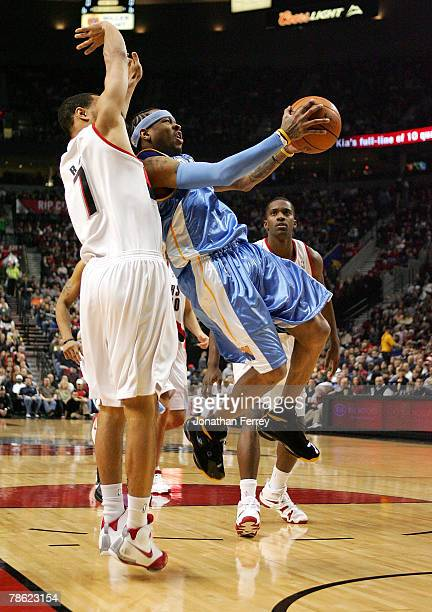 Allen Iverson of the Denver Nuggets lays up the ball against Brandon Roy of the Portland Trail Blazers at the Rose Garden on December 21 2007 in...