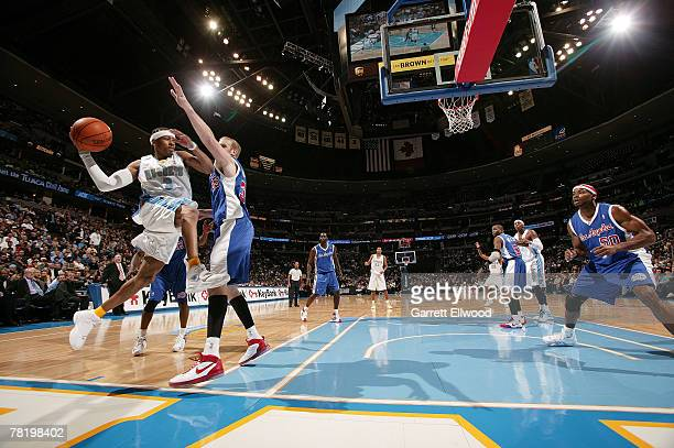 Allen Iverson of the Denver Nuggets looks to make a pass against the Los Angeles Clippers at the Pepsi Center November 30 2007 in Denver Colorado...