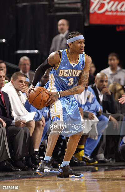Allen Iverson of the Denver Nuggets looks to move the ball during a game against the Portland Trail Blazers at the Rose Garden Arena on January 14...