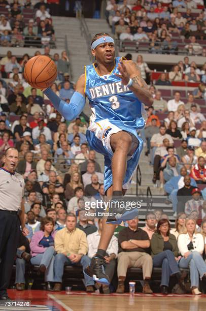 Allen Iverson of the Denver Nuggets looks to pass during a game against the Detroit Pistons on March 26 2006 at the Palace of Auburn Hills in Auburn...
