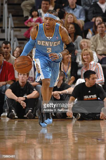 Allen Iverson of the Denver Nuggets moves the ball up court during a game against the Phoenix Suns at US Airways Center on March 30 2007 in Phoenix...