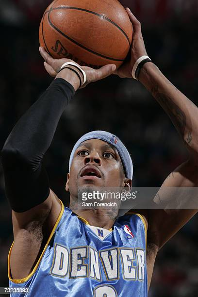 Allen Iverson of the Denver Nuggets prepares to shoot a free throw during a game against the Portland Trail Blazers at the Rose Garden Arena on...