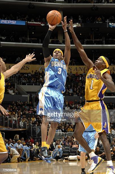 Allen Iverson of the Denver Nuggets puts up a shot against Smush Parker of the Los Angeles Lakers on January 5 2007 at Staples Center in Los Angeles...
