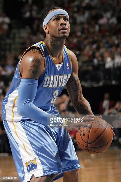 Allen Iverson of the Denver Nuggets shoots a free throw during the game against the Dallas Mavericks at American Airlines Center on December 6 2007...