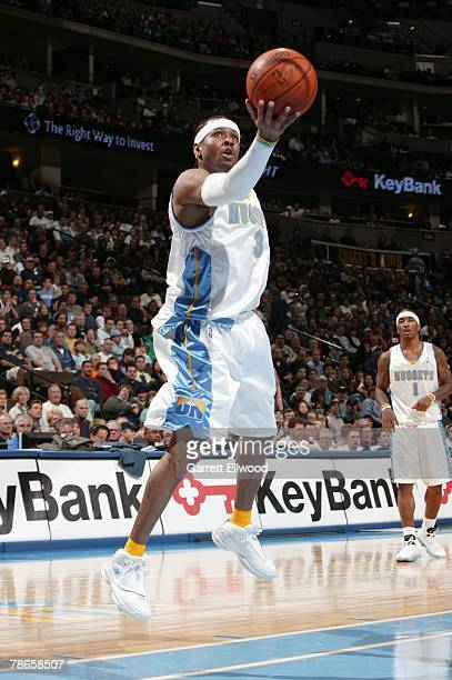 Allen Iverson of the Denver Nuggets shoots a layup during the game against the Miami Heat at Pepsi Center on December 2 2005 in Denver Colorado The...