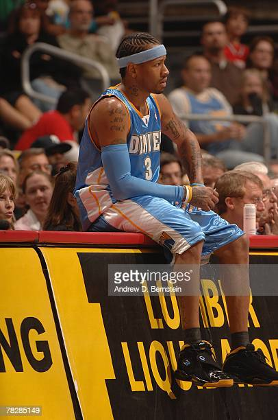 Allen Iverson of the Denver Nuggets sits on the scorers table during the game against the Los Angeles Clippers at Staples Center on November 21 2007...