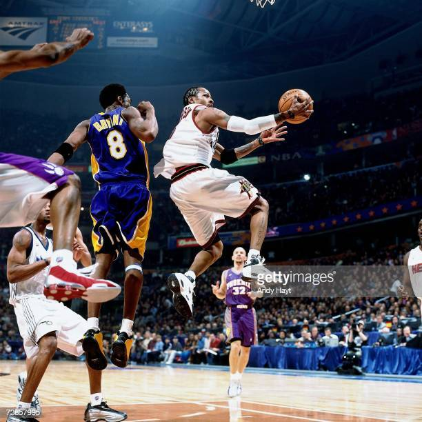 Allen Iverson of the Eastern Conference AllStars attempts a layup against Kobe Bryant of the Western Conference AllStars during the 2001 NBA AllStar...