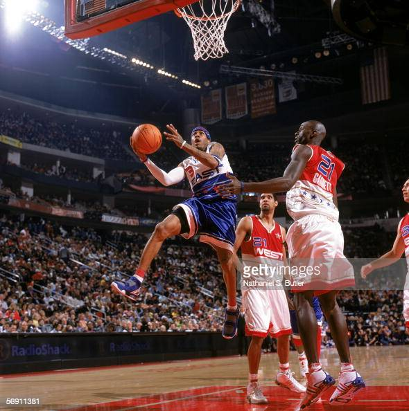 Allen Iverson of the Eastern Conference drives to the basket past Kevin Garnett of the Western Conference during the 2006 NBA AllStar Game at Toyota...