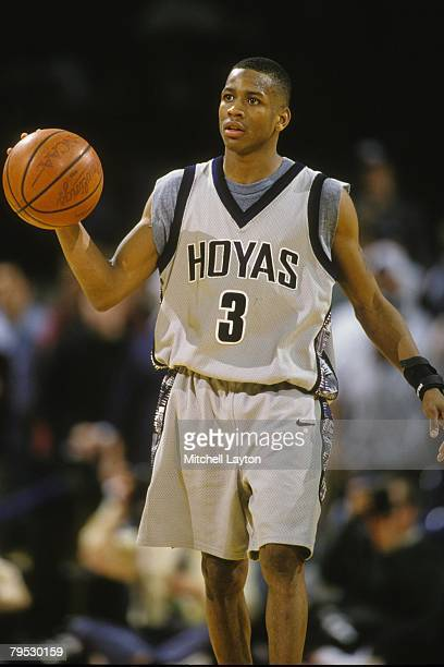 Allen Iverson of the Georgetown Hoya dribbles the ball up courts during a basketball game against the Boston College Eagles at Capital Centre on...